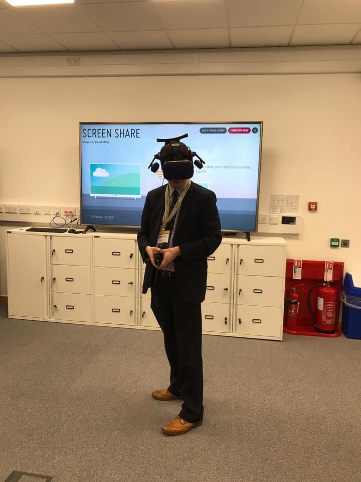 Mr Lee tries out a virtual reality headset as part of AMRC's Digital Theatre Event.